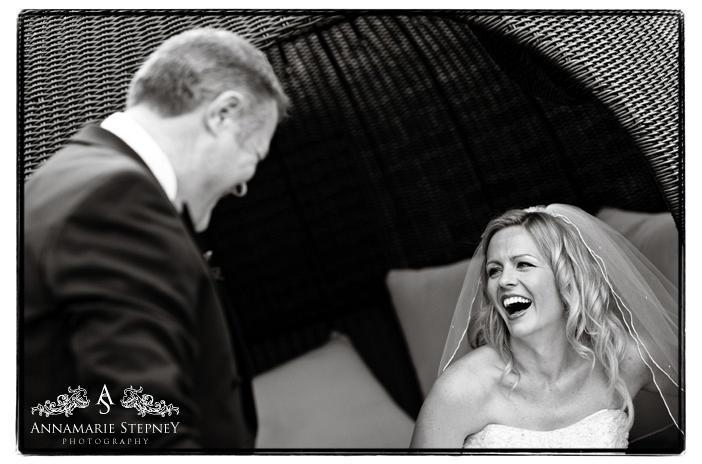 Natural shot of bride enjoying the grooms speech