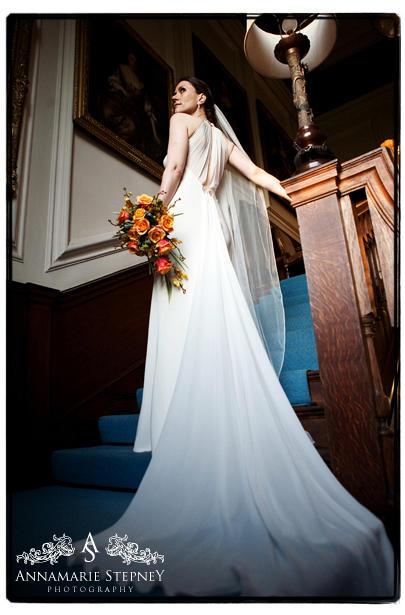 Bride on the grand staircase ~ Adlington Hall Wedding Photography ~ Annamarie Stepney