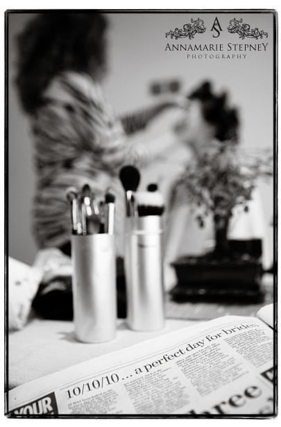 Bride getting makeup in background of newspaper heading ~ Adlington Hall  Wedding Photography ~ Annamarie Stepney