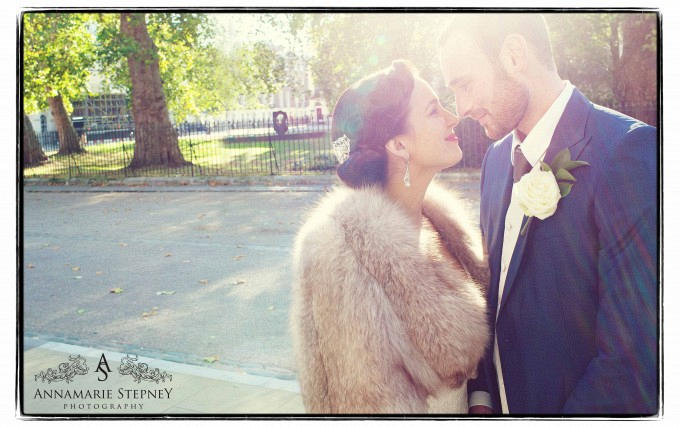Bride and Groom kissing with a sun flare background ~ Six Fitzroy Square Wedding