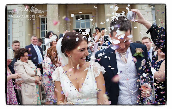 Creative bride and groom confetti shot outside Buxted Park Hotel