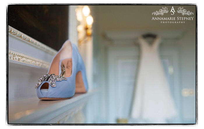 creative wedding shoes shot with wedding dress in the background