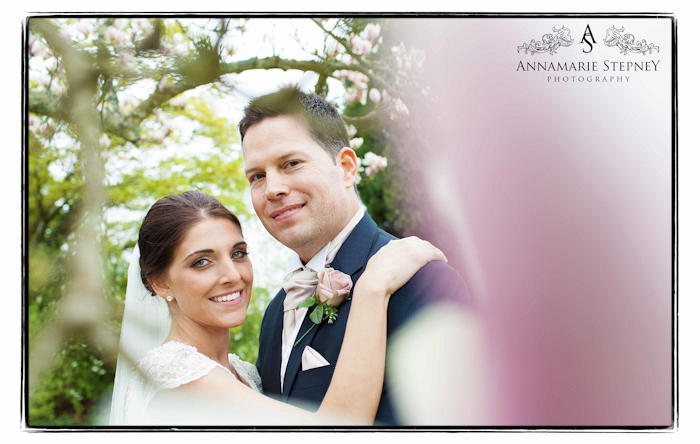 Creative portraiture wedding shot of the bride and groom