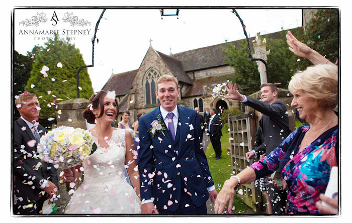 Just married confetti shot of Karen and Jamie outside the church
