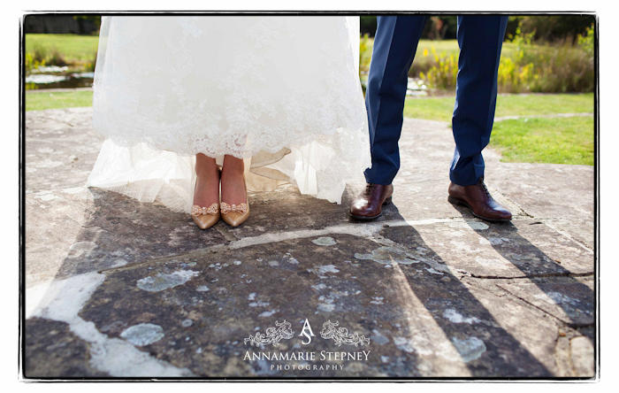Creative wedding shot of bride and grooms shoes