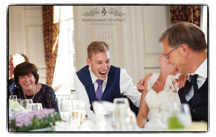 Jamie the groom laughing during his speech